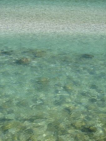 turqoise: Clear water and pebbles of the river Soca, Slovenia  Stock Photo
