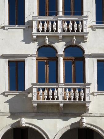 heads old building facade: Facade of a beautiful Renaissance building in Treviso, Italy
