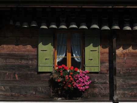 Decorated window of a house in Gstaad photo