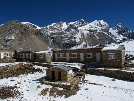 destination scenics: Last lodges before Thorung La pass and high mountains Stock Photo