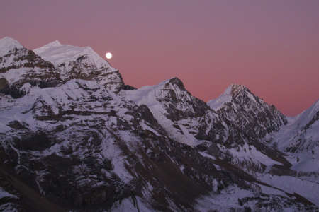Raising moon over Purbung Himal, Nepal photo