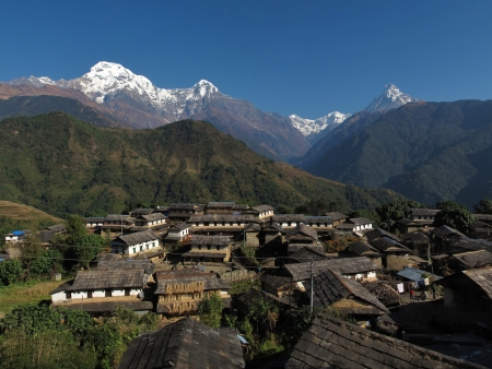 snowcapped: Famous village Ghandruk and snowcapped Annapurna South Stock Photo