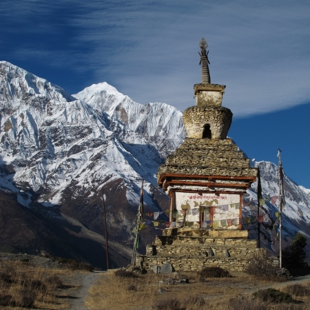 gompa: Stupa and Gangapurna, scene in the Annapurna Conservation Area, Nepal Stock Photo