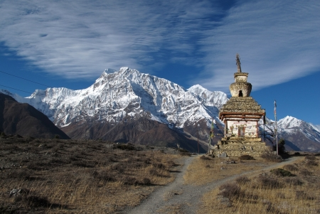 gompa: Snow capped Annapurna Range and stupa, Nepal Stock Photo