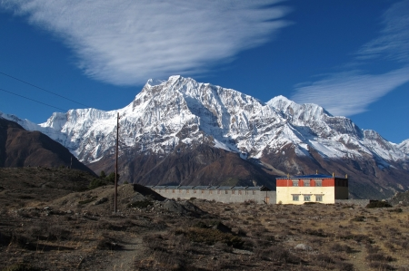 capped: Snow capped Annapurna Range and monastry