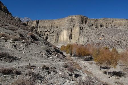 limestone caves: Caves in limestone cliffs near Jomosom, Nepal Stock Photo