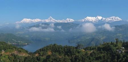 tal: Lake Begnas Tal and snow capped Annapurna Range Stock Photo