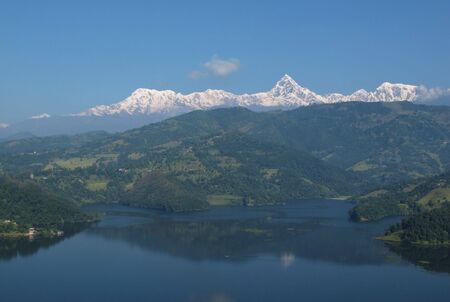 snow capped: Snow capped Annapurna Range and lake Begnas Tal Stock Photo