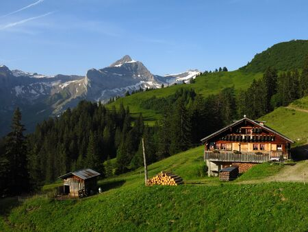 gsteig bei gstaad: Farm house and Oldenhorn, scene in the Bernese Oberland Stock Photo