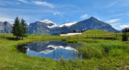 Spitzhorn and pond, scene near Gstaad