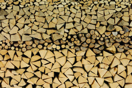Stacked firewood, background photo