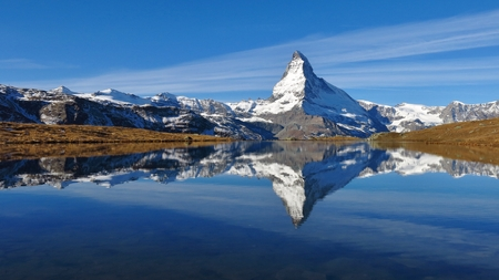 snow capped: Snow capped Matterhorn mirroring in lake Stellisee
