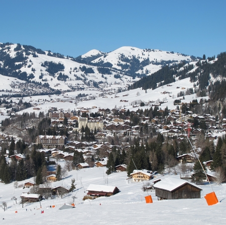 gstaad: Ski slope and view of Gstaad in winter