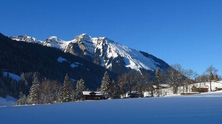 Winter scene in Gsteig bei Gstaad, Swiss Alps