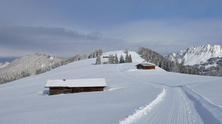 saanenland: Snow covered hill and ski slope