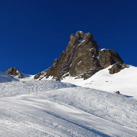 Ski slope and mountain peak, scene in the Flumserberg ski area photo