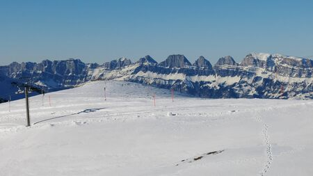 Ski lift and Churfirsten, mountain range in the Swiss Alps