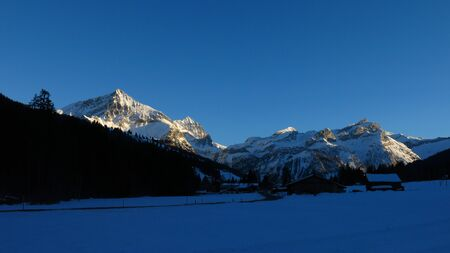 saanenland: Winter evening Feutersoey, Bernese Oberland