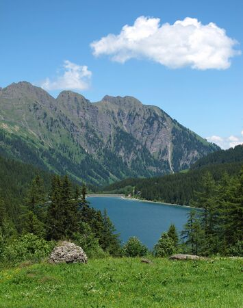 saanenland: Blue lake Arnensee in summer