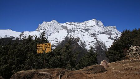 bazar: Signboard and snow capped Kongde Ri scene in the Sagarmatha National Park