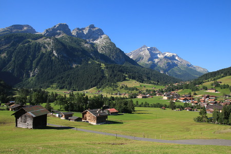 saanenland: Village Gsteig bei Gstaad and high mountains Stock Photo