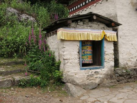 sheltered: Sheltered prayer wheel in the Everest Region Stock Photo