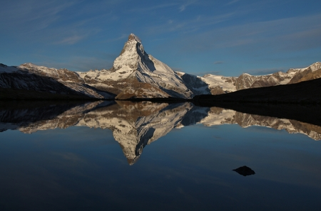 morning light: Snow capped Matterhorn mirroring in lake Stellisee