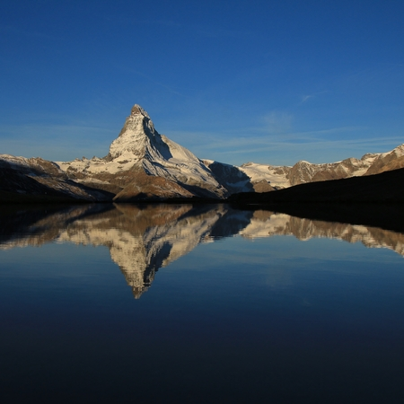 snow capped: Snow capped Matterhorn mirroring in a mountain lake
