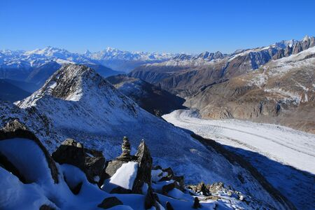 aletsch: Aletsch Glacier and distant view of the Matterhorn, Weisshorn and other high mountains Stock Photo