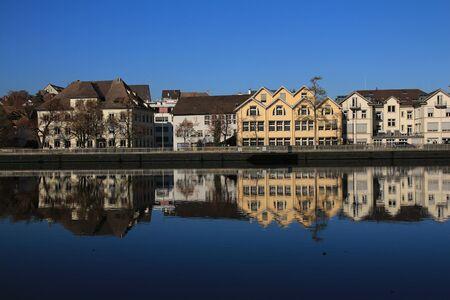 mirroring: Houses in Schaffhausen mirroring in the Rhine Stock Photo
