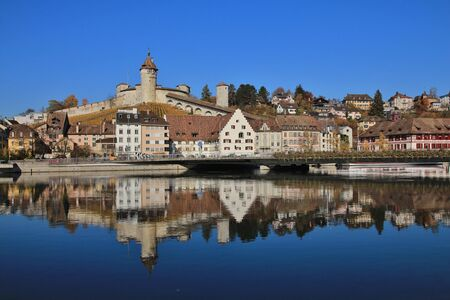 mirroring: Schaffhausen mirroring in the river Rhine Editorial