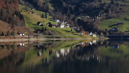 mirroring: Innerthal, little village in Schwyz Canton mirroring in lake Wagital