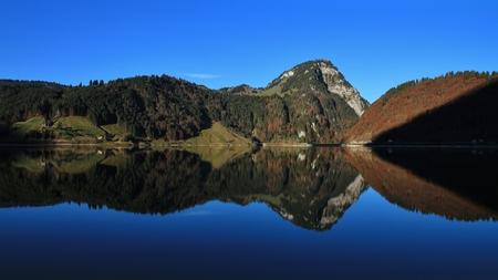 mirroring: Gross Aubrig mirroring in lake Waegital Stock Photo