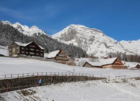 toggenburg: Winter scene in the Toggenburg valley, mountain and traditional architecture