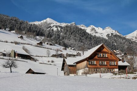 toggenburg: Idyllic winter scene in the Toggenburg valley Stock Photo