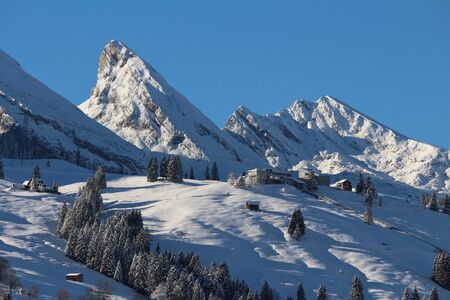 toggenburg: Mountain peaks of the Churfirsten in winter and ski area Stock Photo