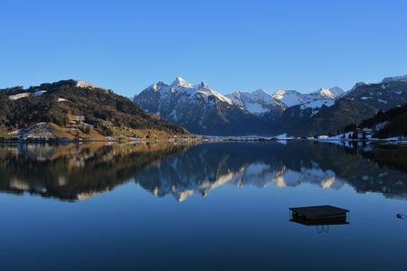 High mountains mirroring in lake Sihlsee