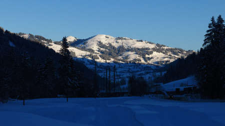 saanenland: Rellerli on a winter morning, mountain in Gstaad