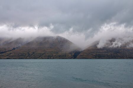 australasia: Lake Ohau and Ben Ohau Rainge on a rainy summer day. South Island, New Zealand. Stock Photo