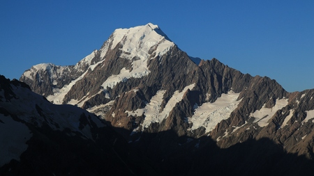 aotearoa: Peak of Mount Cook and glacer. Evening scene on the Sealy Tarns Track. Highest mountain of the Southern Alps.