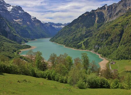 glarus: Spring scene in the Swiss Alps. Lake Kloentalersee, Glarus Canton. View from Schwammhoechi.