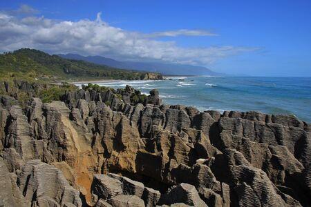blowhole: Pancake Rocks and blowhole in Punakaiki, New Zealand. Stock Photo