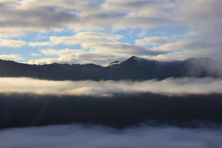aotearoa: Fogy morning in the Southern Alps. View from Mt Robert, New Zealand. Stock Photo