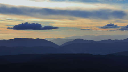 robert: View from Mt Robert, New Zealand. Clouds over mountain ranges at nightfall.