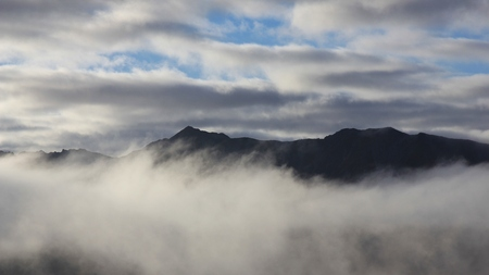 robert: Cloudy morning in the Southern Alps. View from Mt Robert, New Zealand.