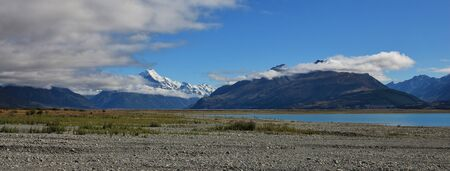 aotearoa: Distant view of Mt Cook. Morning scene in New Zealand. Shore of Lake Pukaki.