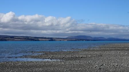 aotearoa: Tuquoise Lake Pukaki. Landscape near Mt Cook, New Zealand. Cloudy morning