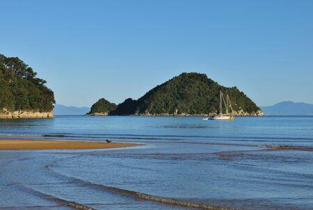 tasman: Small island in the Onetahuti Bay. Abel Tasman National Park, New Zealand.