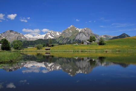 mirroring: Alpstein range mirroring in lake Schwendisee