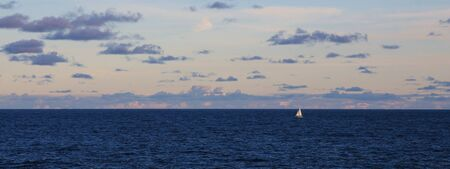 vastness: Sailing boat and vastness of the Pacific ocean. Evening scene in Sydney.